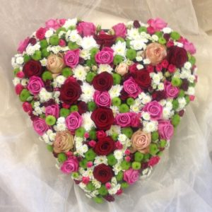 Sympathy flowers by The Flower Den