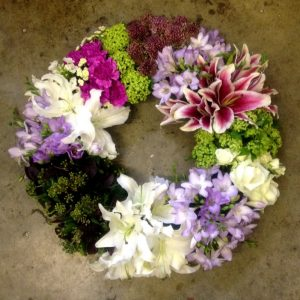 A Circular Wreath Of Grouped Flowers