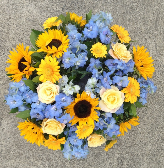 Pale Blue Delphinium With Sunflowers